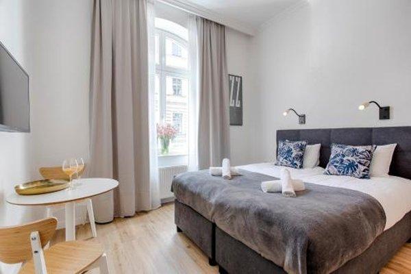 Tyzenhauz Apartments - фото 50