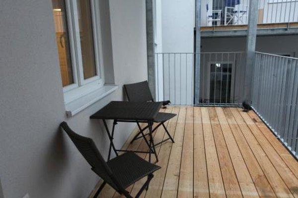 Moderne Stadtwohnung mit Balkon - фото 22