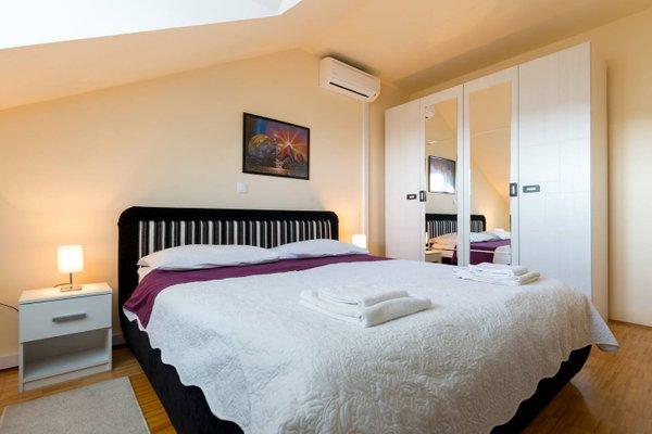 Sunlit Comfort Apartments - фото 27