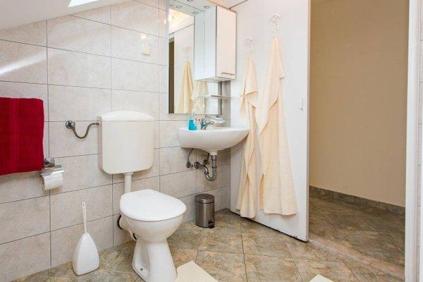 Sunlit Comfort Apartments - фото 11