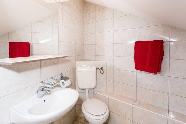 Sunlit Comfort Apartments - фото 12