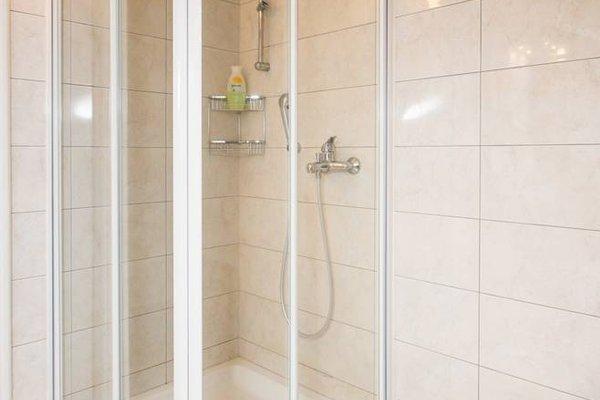 Sunlit Comfort Apartments - фото 13
