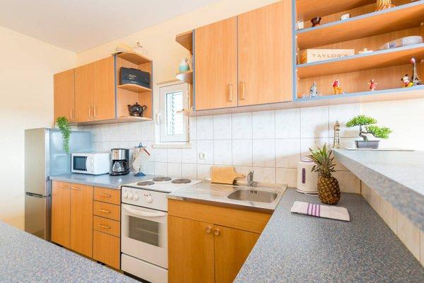 Sunlit Comfort Apartments - фото 14