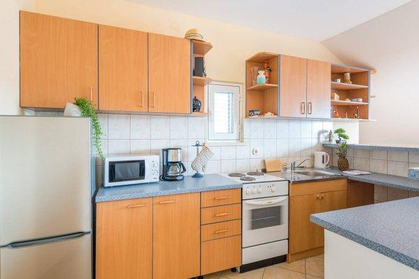 Sunlit Comfort Apartments - фото 15