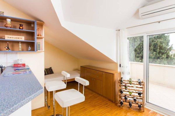 Sunlit Comfort Apartments - фото 16