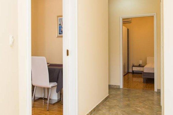 Sunlit Comfort Apartments - фото 17
