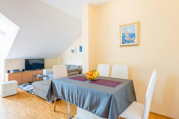 Sunlit Comfort Apartments - фото 4