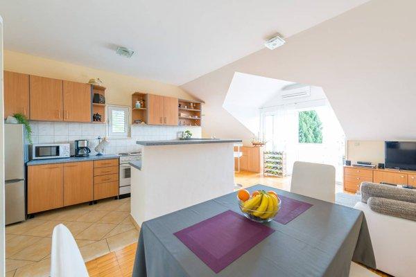 Sunlit Comfort Apartments - фото 7