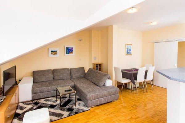 Sunlit Comfort Apartments - фото 8
