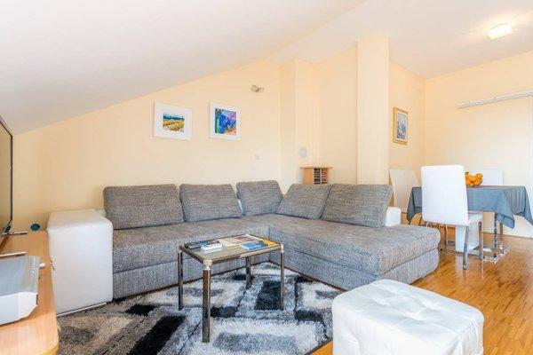Sunlit Comfort Apartments - фото 9