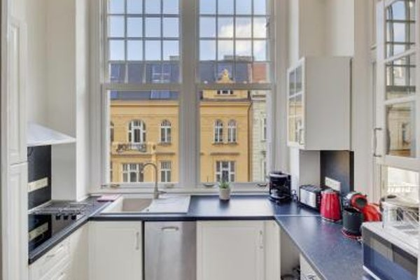 V Kolkovne Old Town Apartment - фото 14