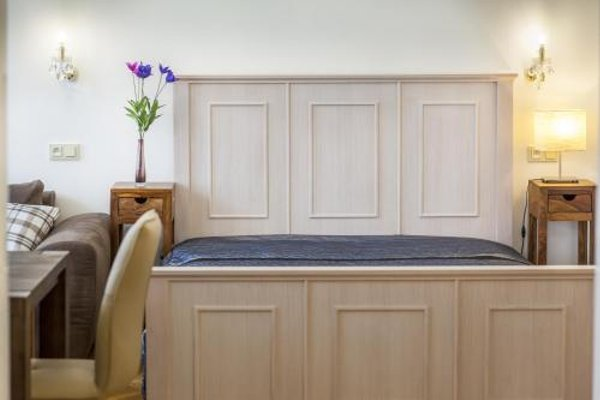 V Kolkovne Old Town Apartment - фото 15