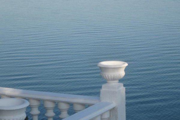 Коттеджи над морем - фото 21