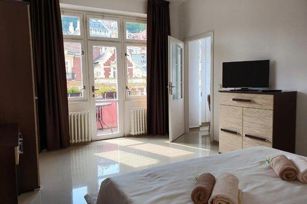 Madonna Apartments - фото 12