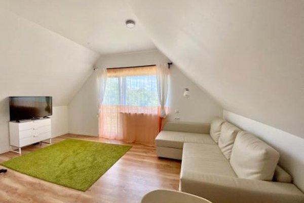 Milne Apartments - фото 16
