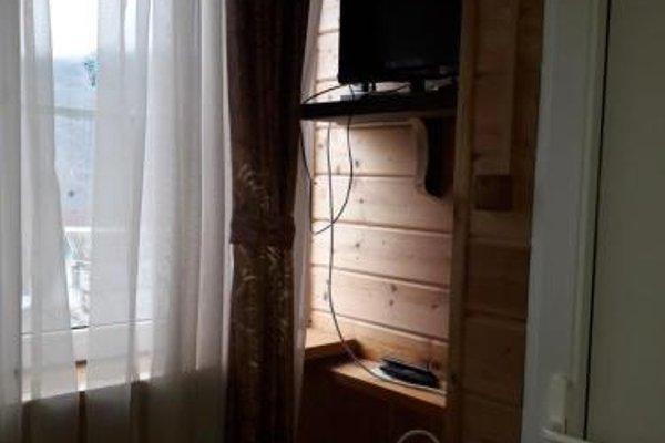 Частный дом с номерами и отдельной кухней - фото 6