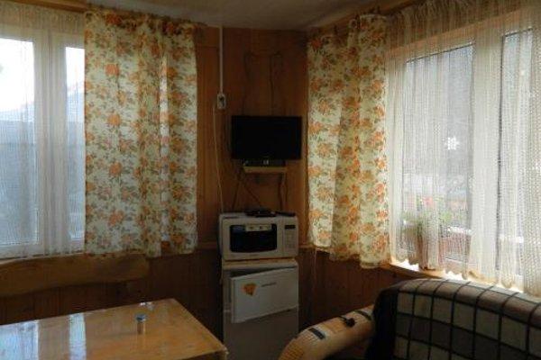 Частный дом с номерами и отдельной кухней - фото 7