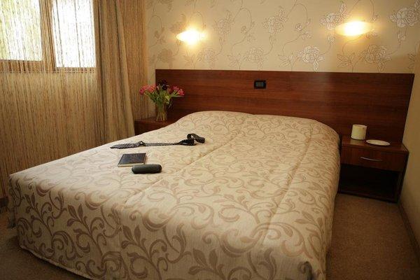 Uniqato Hotel - фото 3