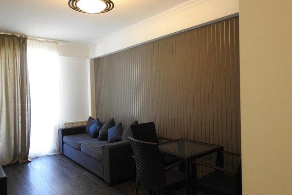 Отель Mgzavrebi Bakuriani - фото 7