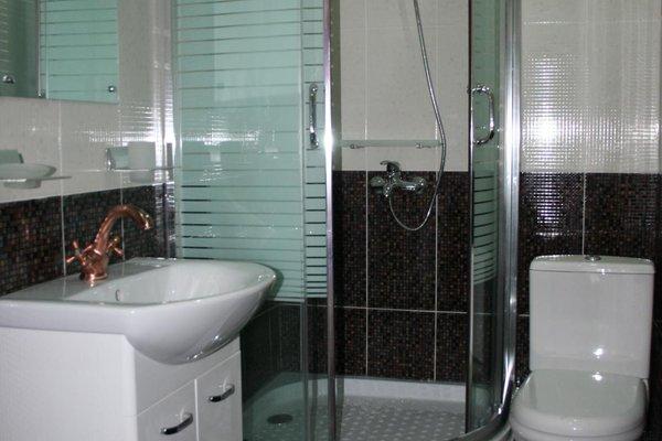 Отель Mgzavrebi Bakuriani - фото 9