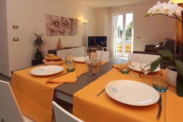 Residence Rivachiara (check-in at Hotel Riviera in Viale Rovereto, 95) - фото 11