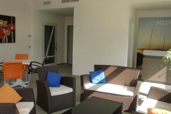 Residence Rivachiara (check-in at Hotel Riviera in Viale Rovereto, 95) - фото 7
