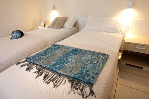Mariposa Apartments - фото 3