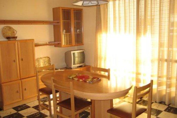 Apartamentos El Oasis - фото 7