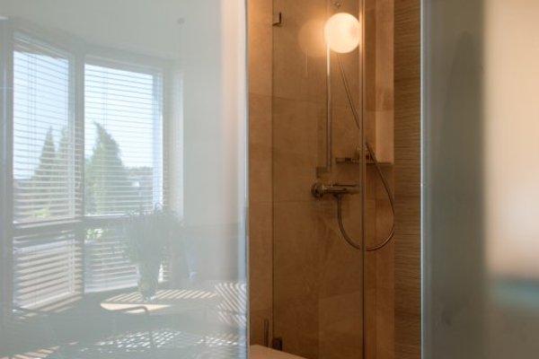 Visit Nida Apartments - фото 10