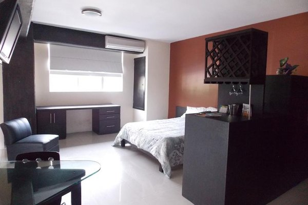 Confort Ejecutivo Suites del Valle - 7