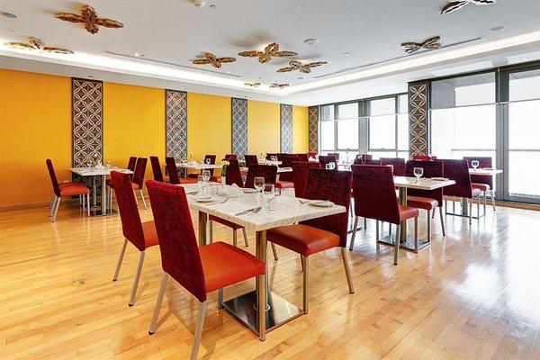 Abidos Hotel Apartment Dubai Land - 11