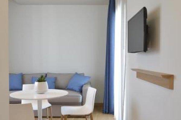 Gaura Apartments - фото 10