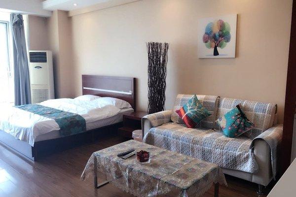 Beijing Golden Apple Apartment - фото 2
