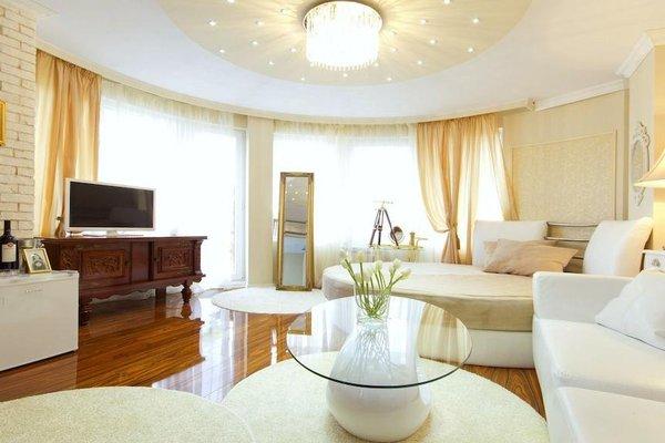 Penthouse Suites Apartments - фото 7