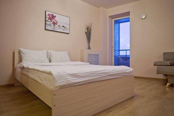 Апартаменты 9 Ночей на Первомайском - фото 40