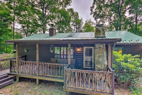 Photo of Quaint Cabin with Outdoor Fireplace and Sunroom!