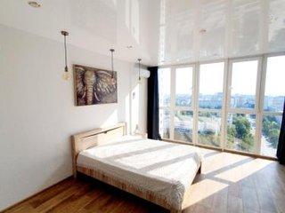 Фото отеля Уютная студия с панорамным видом на 20 этаже в новом доме