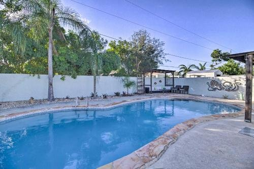 Photo of Tequesta Oasis with Hot Tub and Poolside Backyard