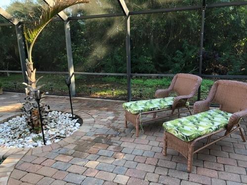 Photo of Tiki Paradise House & pool - 10 min to Beach!