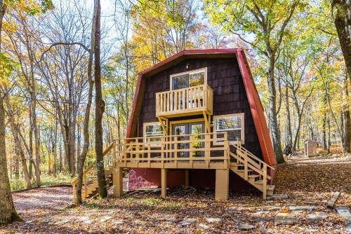 Photo of Cabin with Private Lake & Beach, Fire Pit, & WiFi