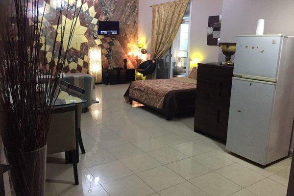Studio Apartment in Ajman - фото 20