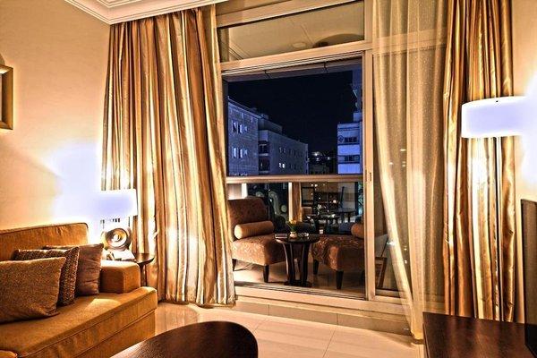 Adamo Hotel Apartments (ех. White Feather Hotel Apartments) - фото 1