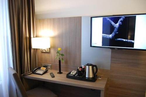 Dom Hotel Am Romerbrunnen - фото 6