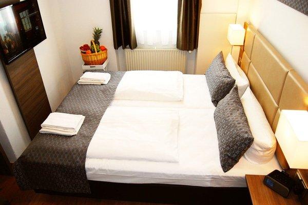 Dom Hotel Am Romerbrunnen - фото 7
