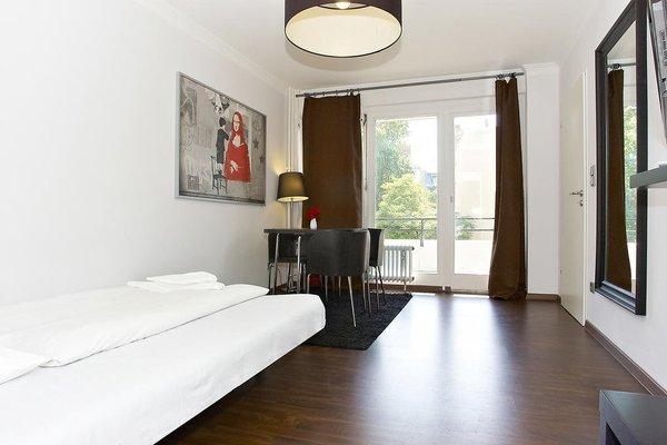 Q Damm Apartments - фото 0