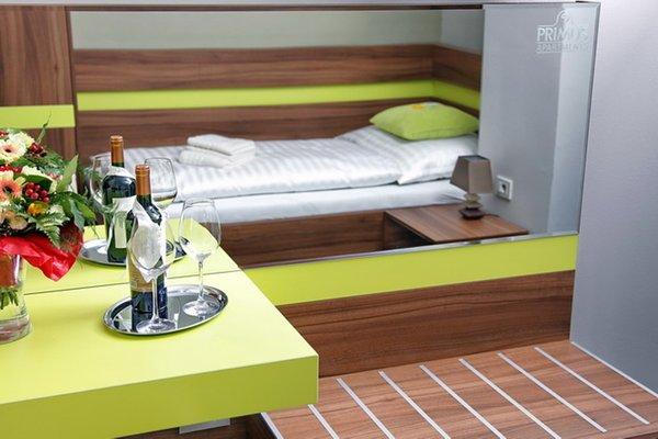 Primus Hotel & Apartments - фото 2