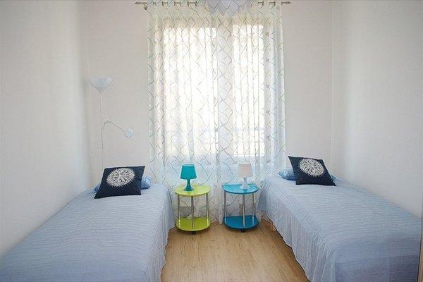 Bright spacious apartment - фото 9