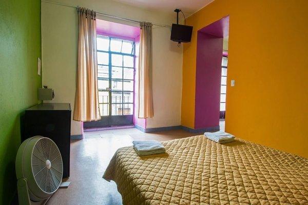 Hostal Amigo Suites - фото 3