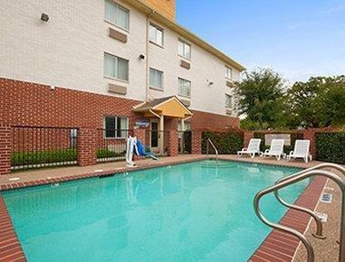 Photo of Days Inn & Suites by Wyndham Dallas