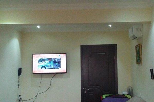 Uchas Apartment - фото 10
